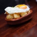 Patatas Bravas with egg