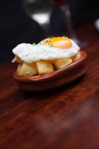 Patatas Bravas with egg